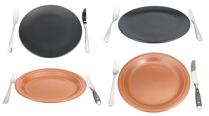 set of empty dinner plates with forks and knifes