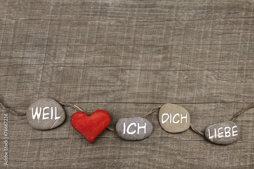 canvas print picture One red heart with stones on wooden background.