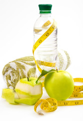 Apple core, bottled water for healthy life over a white backgrou