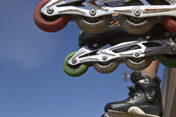 inline skates on ramp in skatepark closeup