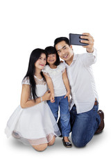 Asian family taking self picture