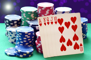 Poker chips pile and royal flush combination of cards