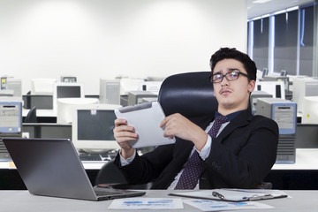 Business leader holding tablet in office