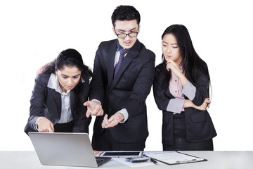 Business partners planning work with laptop