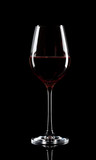 Transparent glass of red wine
