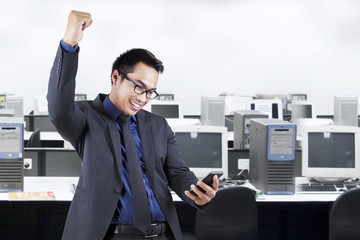 Businessman reading a message in office room
