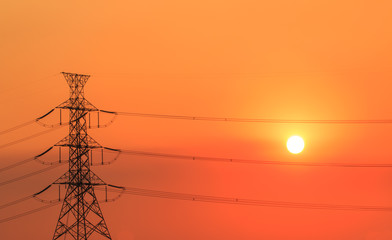 high voltage post.High-voltage tower in sunset time