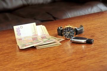 Men watch with a black leather wristband, ukraine money, car tri