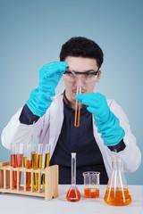 Caucasian scientist doing chemical experiment