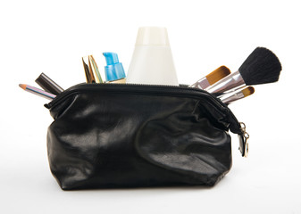 various cosmetics in bag isolated on white background