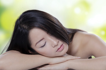 Chinese model relaxing after skin treatment