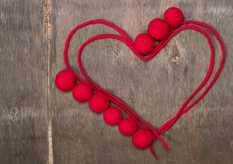 circuit of red heart  and  beads made of wool merino