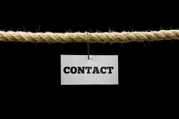 Card with Contact text hanging by wire from a rope isolated on b