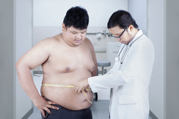 Doctor examining a patient obesity 3