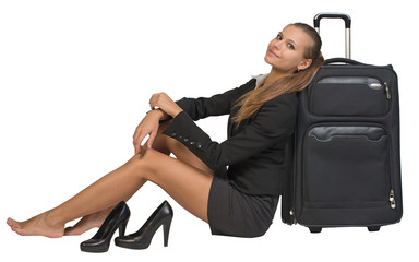 Businesswoman with her shoes off sitting next to front view