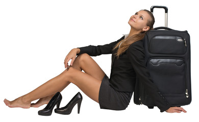 Businesswoman with her shoes off sitting hand resting on the