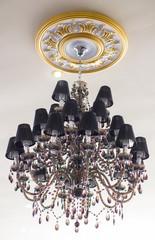 Black chandelier in interior