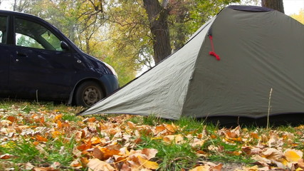 Camping Tent In Autumn Forest. Slider Shot.
