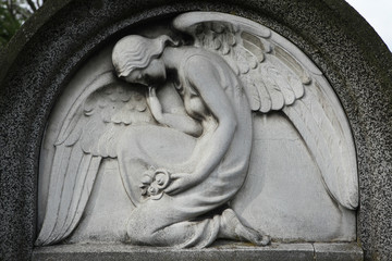 Mourning angel at the abandoned cemetery.