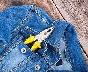 pliers in a pocket of jeans jacket