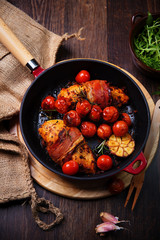 chicken breast wrapped in parma ham with cherry tomatoes