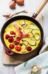 Frittata with zucchini and tomatoes