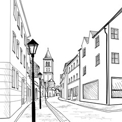 Pedestrian street. Old city church alley. Historic cityscape.