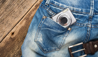 unknown compact digital camera in pocket of jeans with belt on w