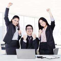 Multi ethnic business team celebrate their success
