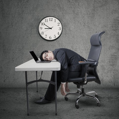 Overworked manager sleeping at desk