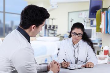 Practitioner write prescription for male patient