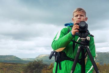 Photographer man in mountain