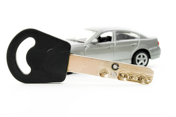 Toy car and key isolated on white background