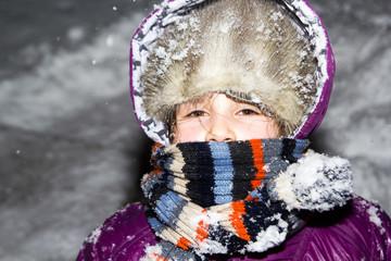 Little girl in snowy night