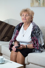 Portrait of woman holding remote