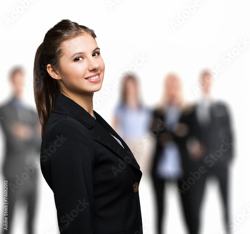 canvas print picture Smiling woman in front of a group of people