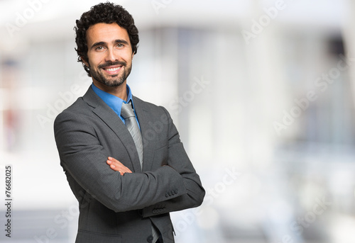 Leinwanddruck Bild Smiling businessman