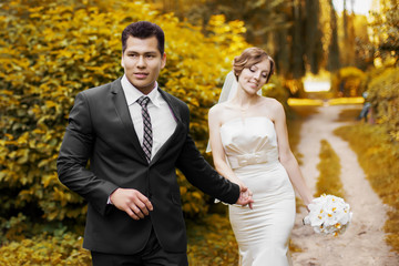 Wedding couple together in park