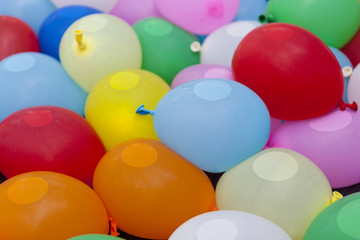 colorful balloons containing water inside for game activity, abs