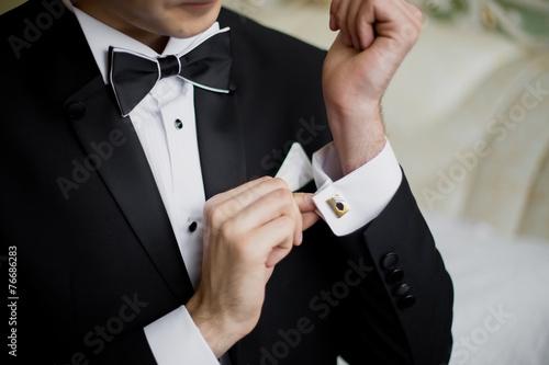 Leinwanddruck Bild men wear a shirt and cufflinks