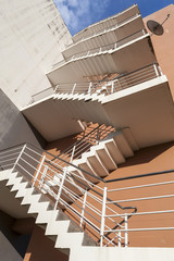 stairs outside bulding, emergency exit, fire escape, orange wall