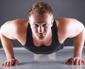 Fitness man doing push ups on floor