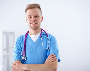 Doctor with stethoscope standing , on white background