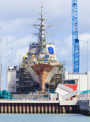 Destroyer under construction in a naval shipyard
