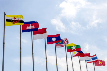 National flags of Southeast Asia nations on blue sky background