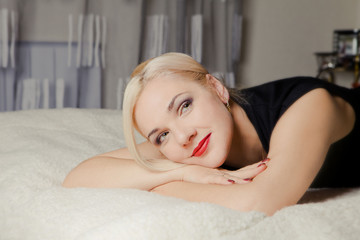 blond woman relaxing at home
