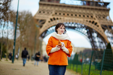 Tourist in Paris, walking with coffee