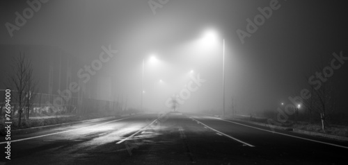 Black and white street at night with fog - 76694000