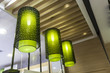 three green chandelier made by cloth hanging on decorative ceili