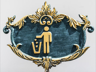 vintage green and gold sign for putting garbage to the trashcan,